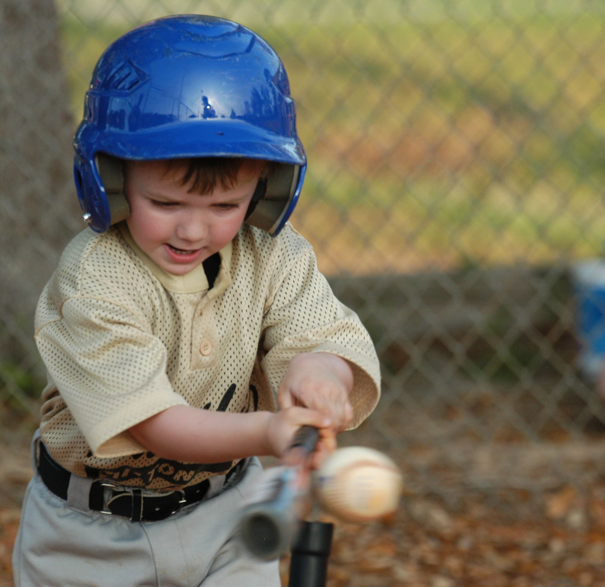 Toddler Hitting a Tee Ball