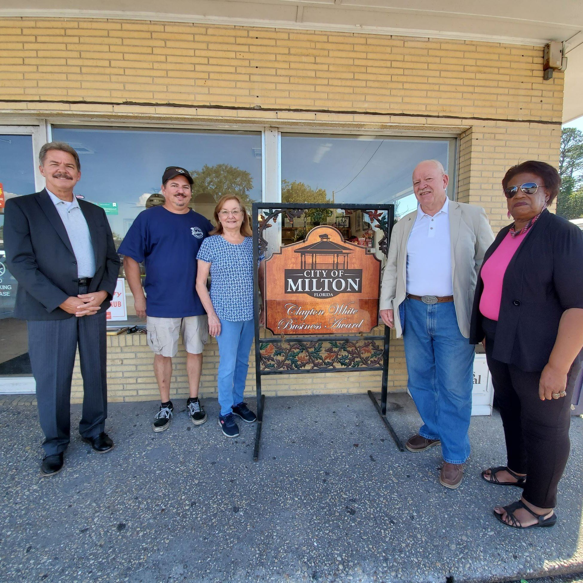 Eric and Frances Michener, owner of Milton Quality Bakery receive the Clayton Williams Business of t