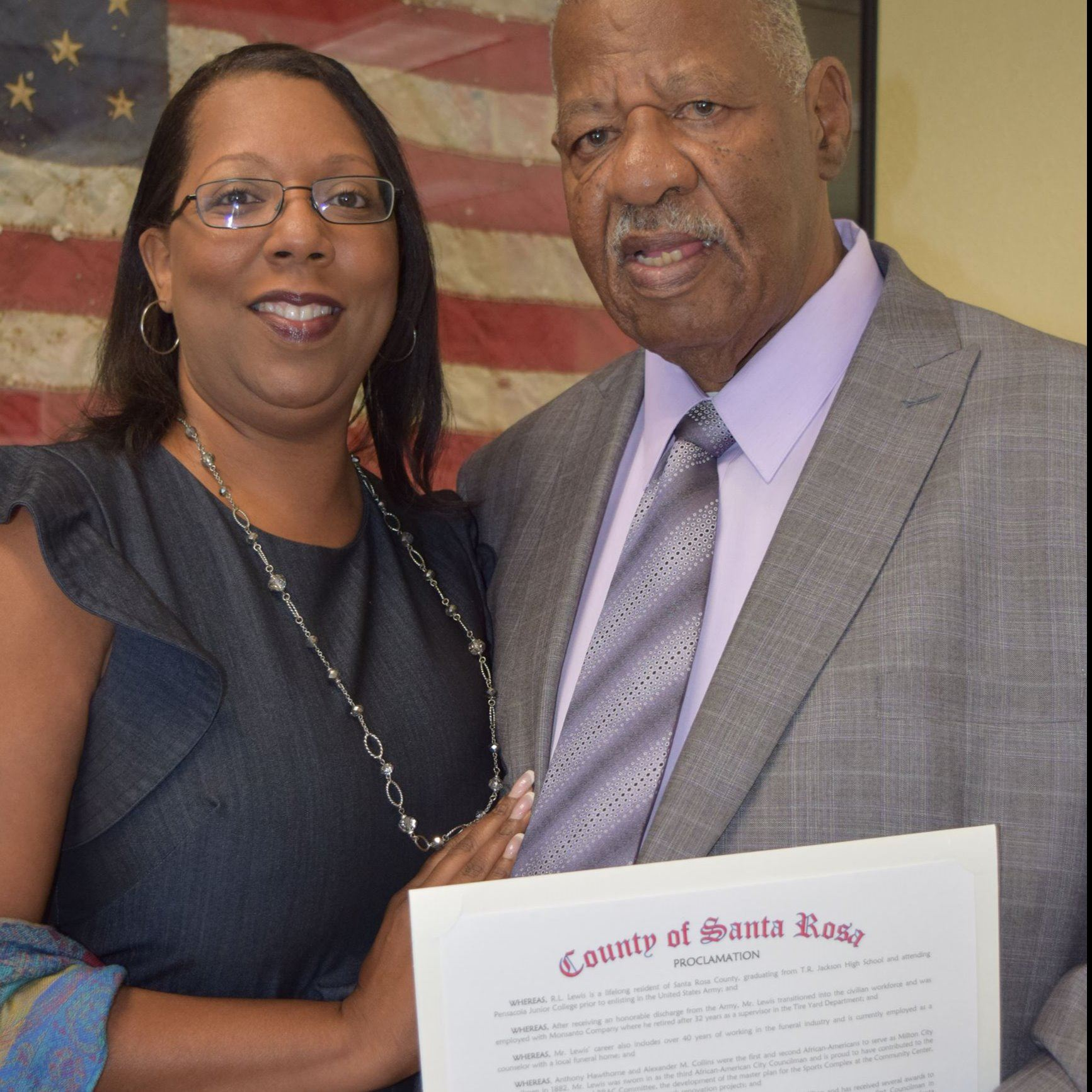 R.L. Lewis and daughter Cheryl Shakur standing together with a proclamation