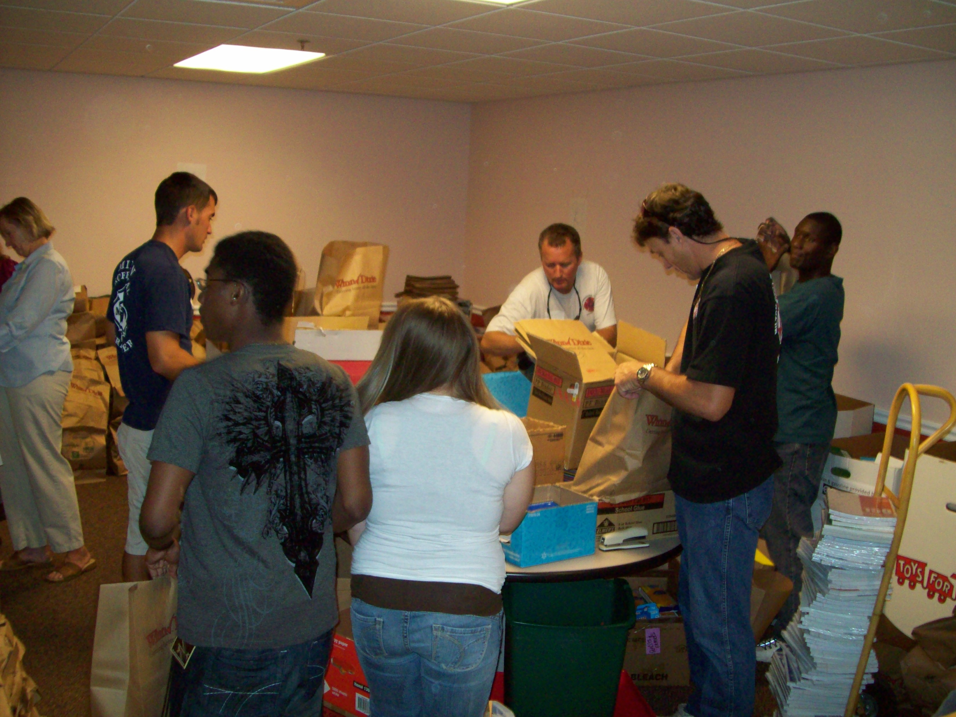 Volunteers Filling Sacks